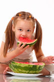 Beautiful little girl eating watermelon Royalty Free Stock Images