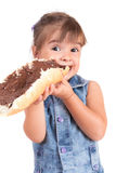 Beautiful little girl eats bread with chocolate cr Stock Photography