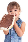 Beautiful little girl eats bread with chocolate cr Stock Images