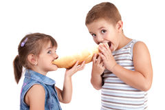 Beautiful little girl eats bread with chocolate cr Stock Photos