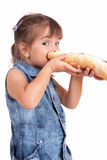Beautiful little girl eats bread with chocolate cr Royalty Free Stock Photography
