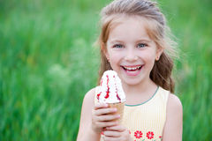 Beautiful little girl eats ice-cream Stock Photo
