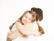 Beautiful little girl embracing her mother on white background. Happy family concept. Mother and her little lovely daughter, concept of togetherness, studio shot Royalty Free Stock Photography