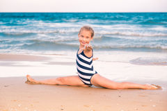 Free Beautiful Little Girl Excercising On The Beach Royalty Free Stock Photo - 33839155