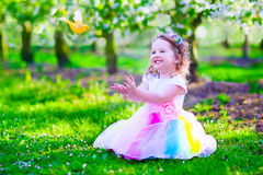 Beautiful little girl in fairy costume feeding a bird Royalty Free Stock Photos
