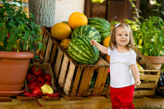 Beautiful little girl at the farmers market. Royalty Free Stock Images