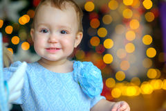Beautiful little girl in a festive interior royalty free stock photo