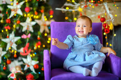 Beautiful little girl in a festive interior stock photography