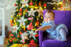 Beautiful little girl in a festive interior royalty free stock image