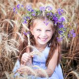 Beautiful little girl  in a field of wheat Stock Photography
