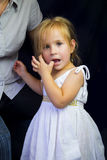 Beautiful little girl with finger in her mouth Royalty Free Stock Photos