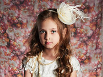 Beautiful little girl. floral background.funny child Royalty Free Stock Photos