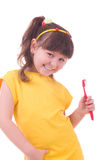 Beautiful little girl flossing her teeth Stock Image
