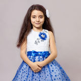 Beautiful little girl with flower in her hair Royalty Free Stock Images