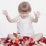 Beautiful little girl with flower petals Royalty Free Stock Photography