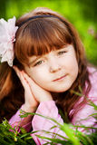 Beautiful little girl in the flowered garden Stock Photo