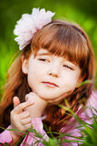 Beautiful little girl in the flowered garden Stock Photo