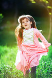 Beautiful little girl in the flowered garden Stock Photography