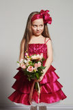 Beautiful little girl with flowers. funny happy child Royalty Free Stock Images