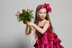 Beautiful little girl with flowers. funny happy child Stock Photo