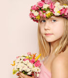Beautiful little girl with flowers Stock Image