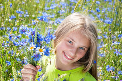 Beautiful little girl with flowers Royalty Free Stock Images