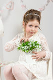 A beautiful little girl with flowers in a pot Stock Photos