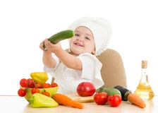Beautiful little girl with food vegetables Royalty Free Stock Images