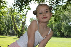 Beautiful little girl in forest portrait royalty free stock image