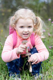 Beautiful little girl found mushrooms Royalty Free Stock Image