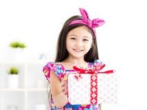 Beautiful little girl with gift box Stock Image