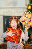 Beautiful little girl  with gift. Royalty Free Stock Images
