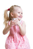 Beautiful little girl with a glass of milk Royalty Free Stock Photography