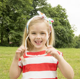 Beautiful little girl with glasses smiling Royalty Free Stock Photos