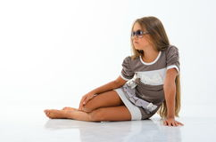 Beautiful little girl with glasses in the studio. Stock Photography