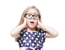 Beautiful little girl in glasses surprised isolated Stock Photography