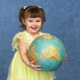 Beautiful little girl with globe. Beautiful little girl with the geographic globe Stock Photography