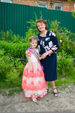 Beautiful little girl with grandmother outdoor Stock Photo