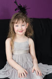 Beautiful little girl in a gray dress Stock Photo
