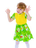 Beautiful little girl in a green dress fun Royalty Free Stock Images