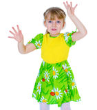 Beautiful little girl in a green dress fun waves his hands Stock Images