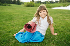 Beautiful little girl on the green grass Stock Photography
