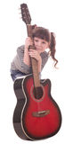 Beautiful little girl with guitar Royalty Free Stock Photography