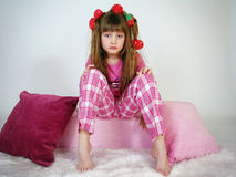 Beautiful little girl with hair curlers Stock Photography
