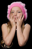 Beautiful little girl with hands on face Stock Image