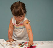 The beautiful little girl with hands in the paint Stock Photography