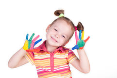 Beautiful little girl with hands in the paint Royalty Free Stock Images
