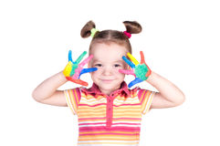 Beautiful little girl with hands in the paint Royalty Free Stock Photos