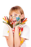 Beautiful little girl with hands painted Stock Images