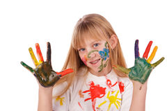 Beautiful little girl with hands painted Royalty Free Stock Image